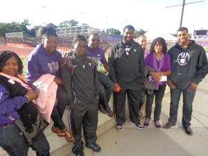 Ayo Okesanya (third from left) and Joel Hylton (fifth from left) with family and friends Photos by Charles Hallman
