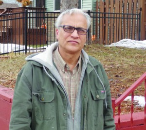 Mahmood Khan outside a rental property in North Minneapolis