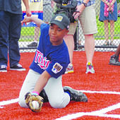 Robert Logan, Jr. catching the ceremonial first pitch from Rod Carew Photos by Anika Nicole Craven