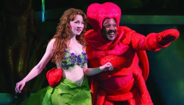 Sebastian the Crab does his best to keep the Little Mermaid out of trouble in a previous production of the musical.  Andre Shoals plays Sebastian in  the current Chanhassen production.