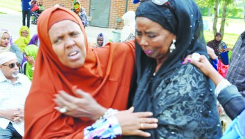 Aibo Mohamed (at right), Warsame's sister,  being consoled by friends