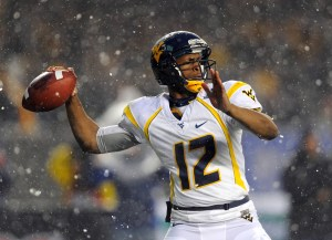 West Virginia Mountaineers QB Geno Smith (12) drops back to pass during the second quarter against the Syracuse Orange at the 2012 New Era Pinstripe Bowl at Yankee Stadium. Credit: Rich Barnes-USA TODAY Sports