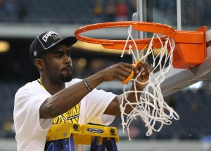 Michigan Wolverines guard Tim Hardaway Jr. (10) celebrates as he cuts the net after their victory over the Florida Gators 79-59 in the South regional final of the 2013 NCAA Tournament at Cowboys Stadium. Mandatory Credit: Matthew Emmons-USA TODAY Sports