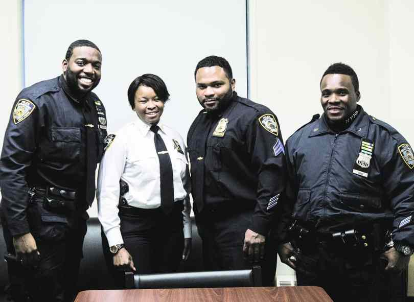 From left to right: Officer Terence Williams, Captain Neteis Gilbert, Sgt. Anwar Yearwood and Officer Louis, of NYPD's Police Service Area 1. (photo by Noah Phillips)