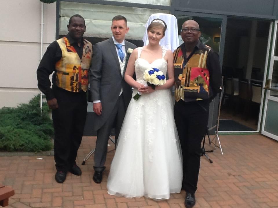 Steelasophical wedding steel band with bride and groom posing photoshoot wedding photography