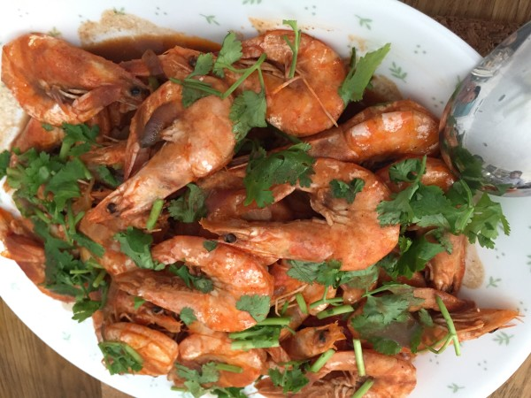 Stir-fried prawns with a generous topping or coriander.