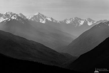 A black and white photograph of the Elwha River valley and the Olympic Mountains as viewed on a cloudy Spring day from Hurricane Ridge in the Olympic National Park, Washington.