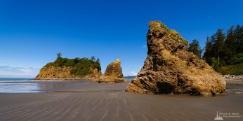 A photograph of Ruby Beach (Olympic National Park, Washington) at low tide on a sunny Spring day.