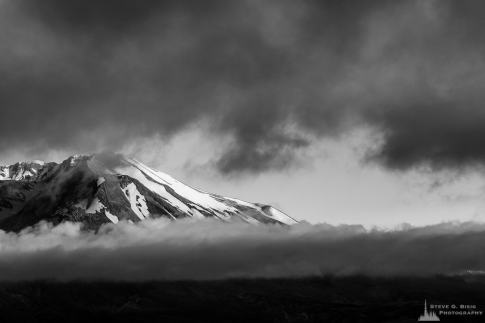 A black and white photograph of Mount Saint Helens shrouded by Summer clouds. Viewed from the Johnston Ridge Observatory, Washington.