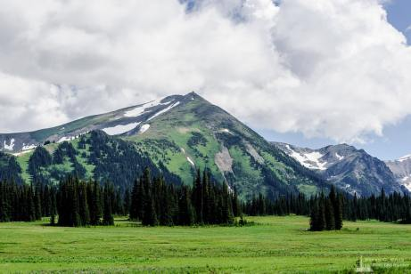 A landscape photograph looking up to Mount Fremont on a cloudy day from the Grand Park area of Mount Rainier National Park, Washington.