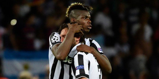 Juventus' midfielder Andrea Pirlo (R) and Juventus' French midfielder Paul Pogba reacts after the UEFA Champions League Final football match between Juventus and FC Barcelona at the Olympic Stadium in Berlin on June 6, 2015. FC Barcelona won the match 1-3. AFP PHOTO / OLIVIER MORIN