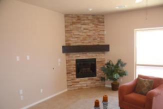 Fam Room Corner Fireplace