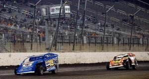FORT WORTH, TX - MAY 16:   Ryan Gustin, driver of the #19 Modified division, leads Clyde Dunn, Jr, driver of the #88 Modified division, during the Modified Championship at the Portacool Texas World Dirt Track Championship at Texas Motor Speedway on May 16, 2015 in Fort Worth, Texas.  (Photo by Mike Stone/Getty Images for Texas Motor Speedway)