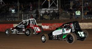 #16B Bryan Clauson races with #16 Mike Martin at Canyon Speedway. Photo by Patrick Shaw / Backed In Photography.