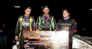 Lincoln winner Bryan Clauson is flanked on both sides by 2nd place finisher Chris Windom (right) and third-place Chase Stockon (left). (MICHAEL FRY PHOTO)