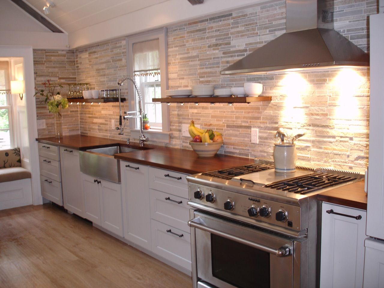 how to choose a wood countertop for your kitchen wood kitchen countertops Mahogany wood countertop provides a warm contrast to stainless steel and white shaker kitchen cabinets