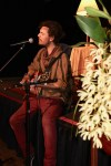 As people gathered for stories, Zack Lewis-Griffiths sang originals