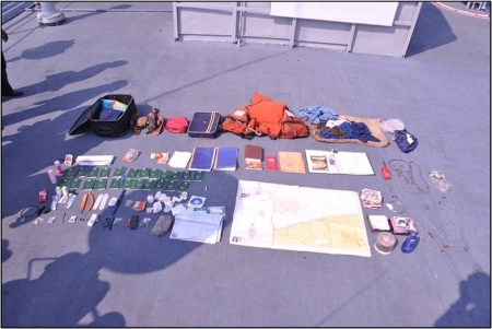 Items recovered from the Prantalay 11. The 23 green notebooks are temporary Thai passports.