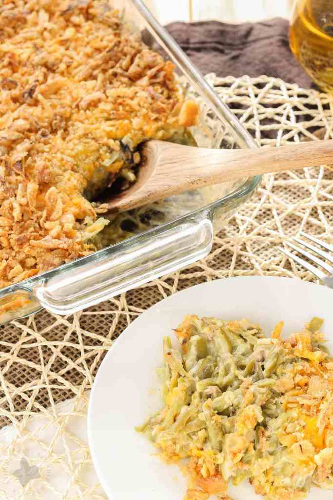 Skip the can of soup this year and make The Best Green Bean Casserole, from scratch. This version is packed with flavor from the made from scratch fresh mushroom soup, french style green beans, cheddar cheese and french fried onions. You'll never go back to the can of soup again! | Strawberry Blondie Kitchen