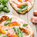 Tender and sweet peaches are a match made in Heaven with salty prosciutto, tangy, creamy goat cheese all piled high on garlic naan bread. This Grilled Peach, Prosciutto and Goat Cheese Pizza will have your taste buds singing the sweet and savory tunes of summer | Strawberry Blondie Kitchen