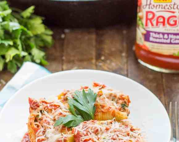 These veggie stuffed shells are packed with hearty vegetables, creamy cheese and smothered in delicious garlic Ragu Homestyle Pasta Sauce. They're so good, even the meat eaters will be asking for seconds! | Strawberry Blondie Kitchen