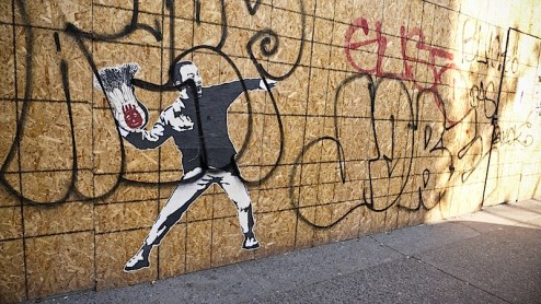 an imitation banksy character throws tom hank's wilson ball in NYC