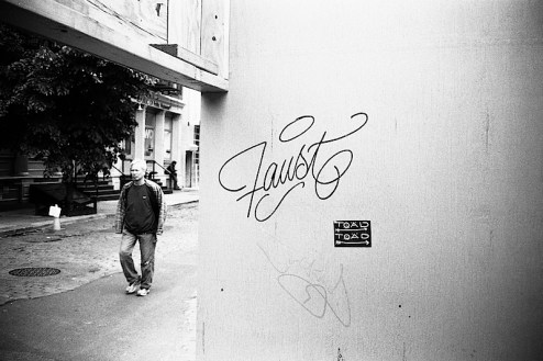 faust graffiti street art found in SoHo, NYC and shot with a Contax t2 camera with Ilford hp5 film