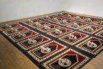 Zoulikha Bouabdellah, Silence, 2008-2015 Installation: 24 tapis de prière, 24 paires de chaussures, 300 x 560 cm.