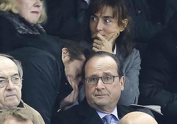 بالصور: رد فعل الرئيس الفرنسي لحظة إبلاغه بتفجيرات باريس.. ذهول وخوف!