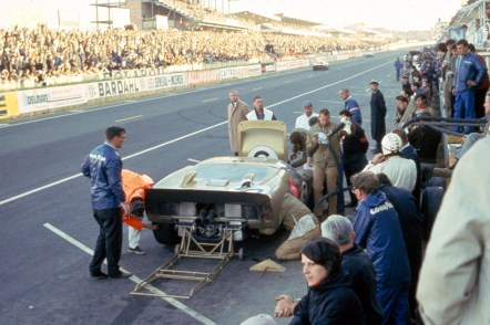 24 Hours of LeMans, LeMans, France, 1966. Ron Bucknum/Dick Hutcherson Holman Moody Ford Mark II makes pit stop. CD#0554-3252-2890-4.