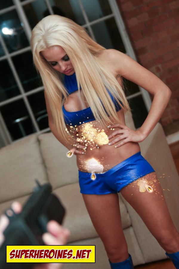 Model Gemma Hiles as Mega Girl in hotpants and bra
