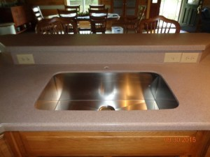 After: Four Sink Faucet Holes were Succesfully Plugged and the Corian Sink was Upgraded to a Single, Bowl Stainless Steel Sink