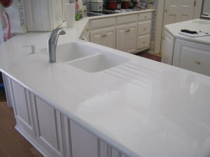 After: In Addition to the New Sink, we filled the previous drainboard area, and created a new drainboard for the Customer!
