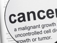 Lung cancer set to overtake breast cancer as biggest cause of cancer deaths in women depicted by swain and co solicitors with a magnified dictionary definition of cancer
