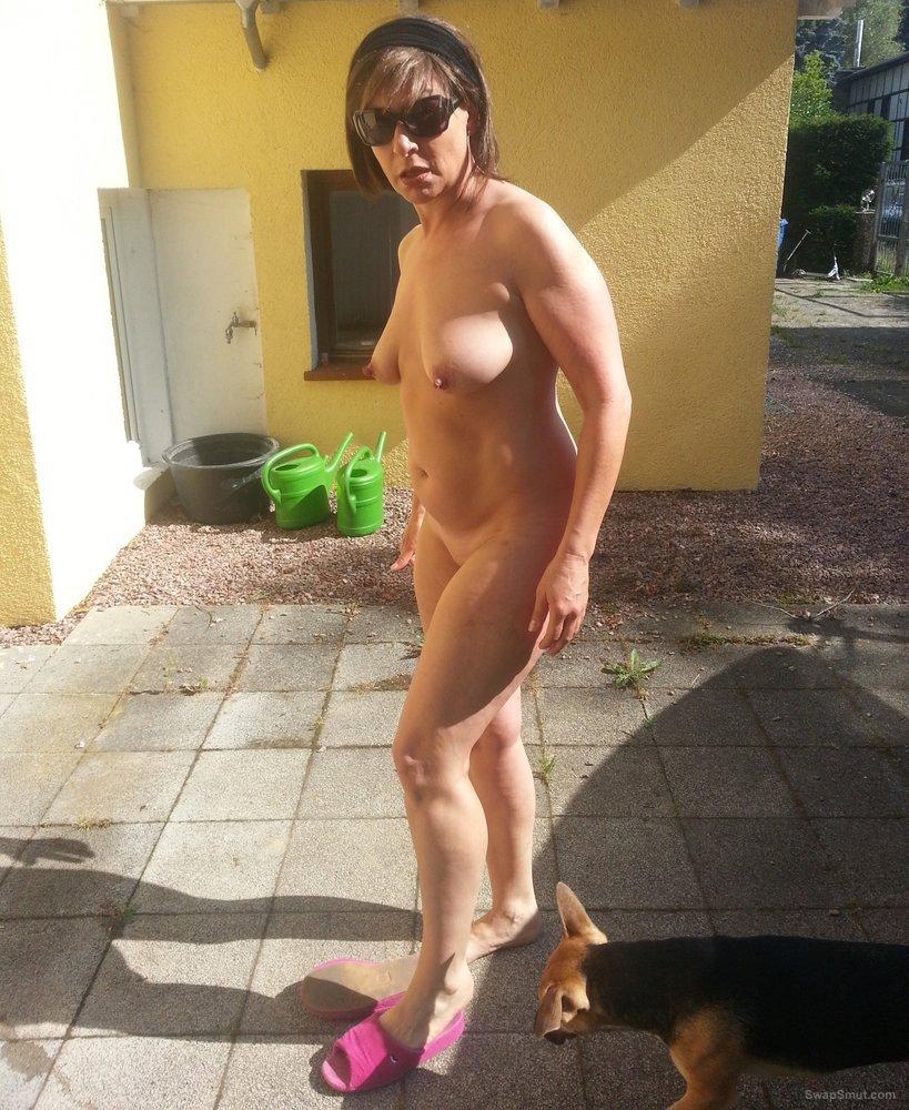 family nude in backyard