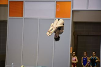 KNOXVILLE, TN - July 31, 2014: Jennifer Giacalone dives from the 1 meter springboard during the 2014 USA Diving Age Group and Junior National Event at Allan Jones Aquatic Center in Knoxville, TN. Photo By Matthew S. DeMaria
