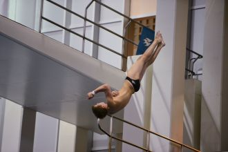 KNOXVILLE, TN - July 31, 2014: Parker Johnson dives of the Platforms during the 2014 USA Diving Age Group and Junior National Event at Allan Jones Aquatic Center in Knoxville, TN. Photo By Matthew S. DeMaria