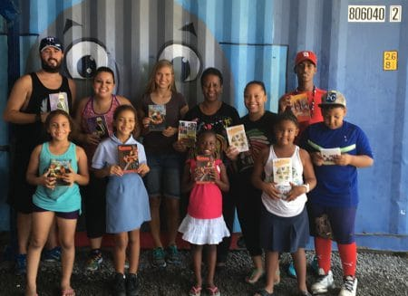 Caption2: Chiaira Bowers of K1 Britannia (L) and author Felecita Williams with books and booklets presented by HNP for K1's youth literacy and motivation activities. (CB Photo)
