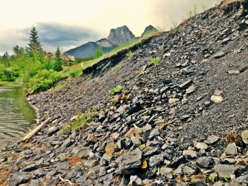 Coal on the edge of the Bow River, near the old coal mines in Canmore, Alberta.