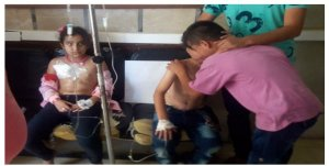 Syrian children receiving care after their primary school was bombed