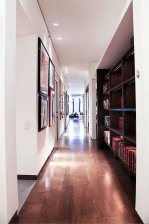 Hallway - Custom cabinetry line hallway. Flooring is wide plank quater sawn oak.