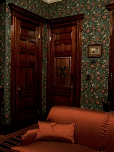 Greene St. Brownstone-A view of closet door and door leading into front hall. Wallpaper was hung.