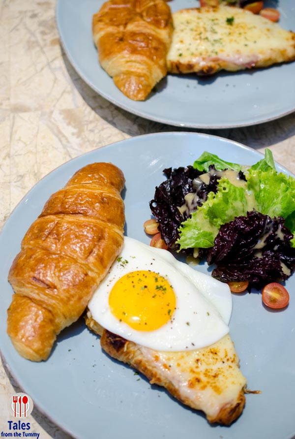 Croque Madame (P395). A croissant with a layer of bechamel sauce ...