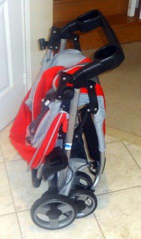 evenflo stroller how to open