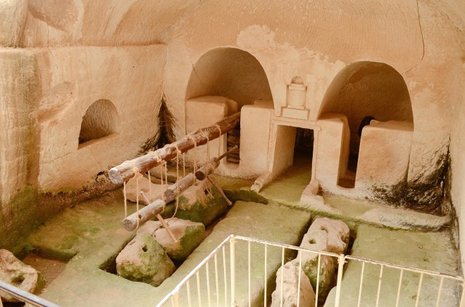 """A typical ancient olive press in an underground cave. Gethsemane or """"Gat Shemenim"""" in Hebrew, is literally """"a place where oils are pressed."""" Perhaps it was a place like this where Jesus suffered the night before his betrayal."""
