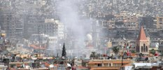A view shows smoke rising after mortar bombs landed on a neighborhood in Damascus