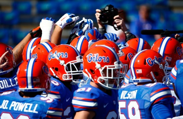 GAINESVILLE, FL - NOVEMBER 15:  Florida Gators players warm up before the game against the South Carolina Gamecocks at Ben Hill Griffin Stadium on November 15, 2014 in Gainesville, Florida.  (Photo by Sam Greenwood/Getty Images)