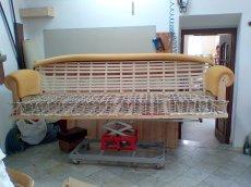 Restauro Divano usato quattro posti con seduta in molle con legatura a mano