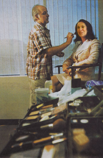 Makeup artist Chris Scott prepares Tara Fields before a segment