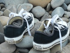 converse trainers on the beach by tartan thrifty